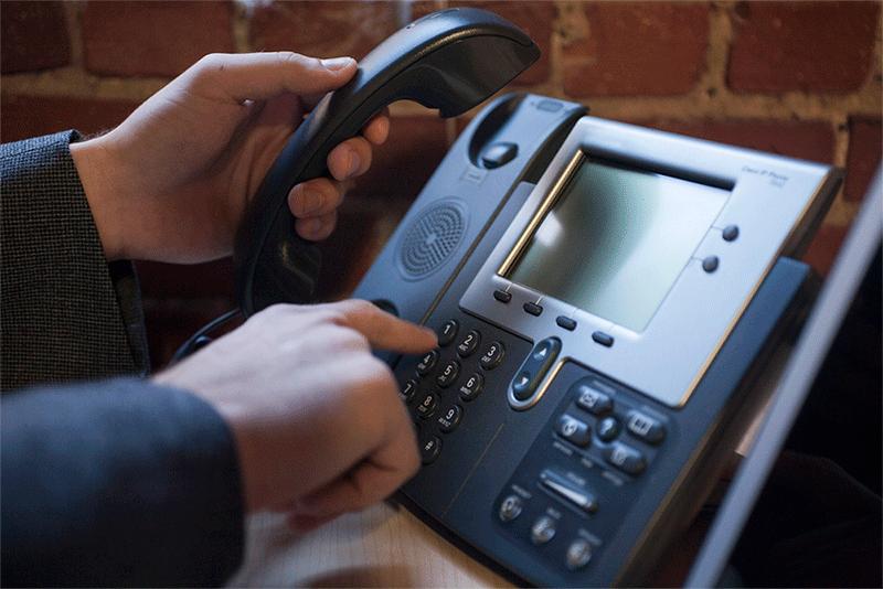 Man-dialing-phone