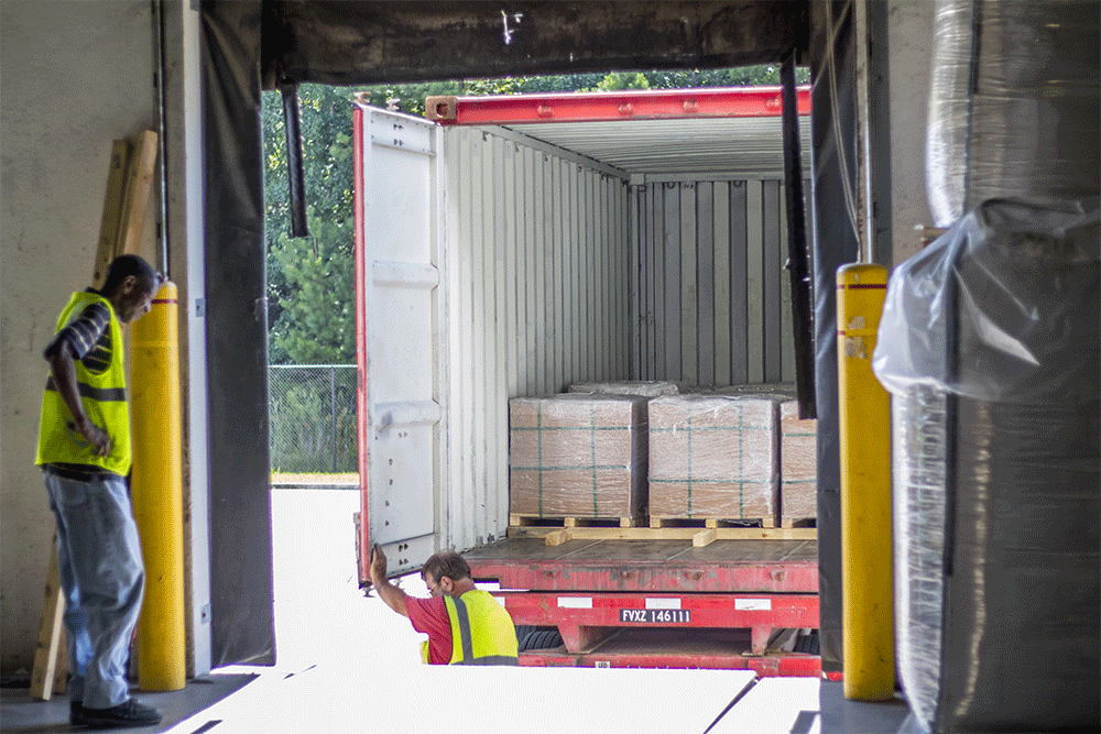 Shipping container at warehouse