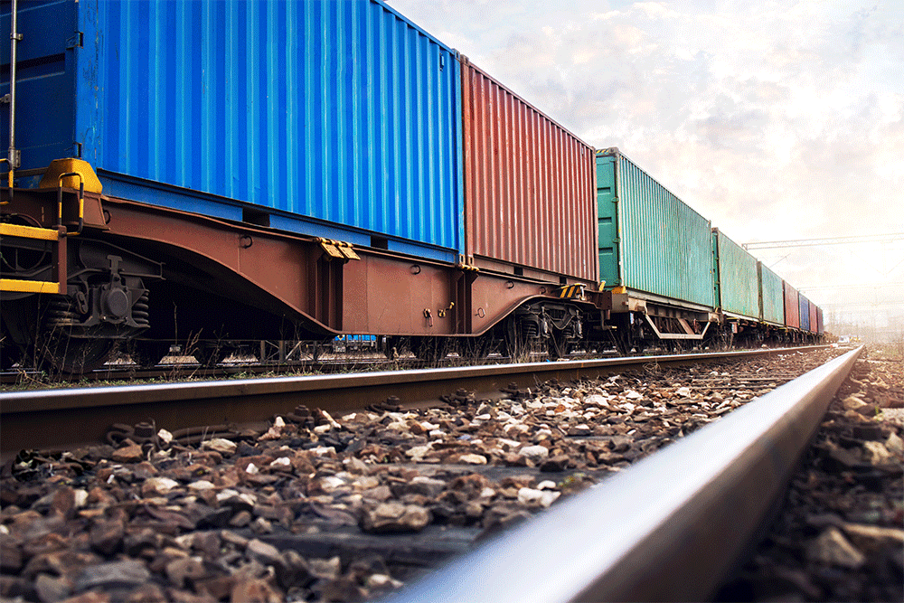 Shipping containers on train cars