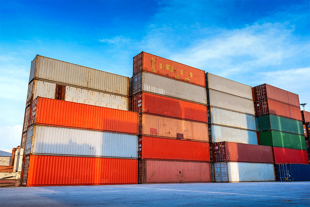 Shipping containers stacked in port