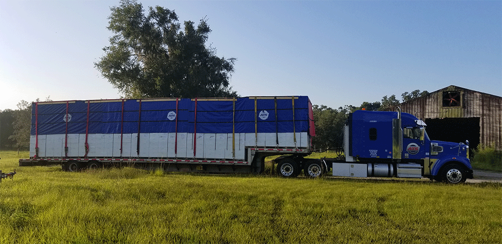 Tarped load on a step deck trailer