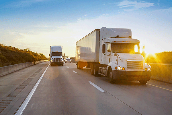 two-semis-on-highway