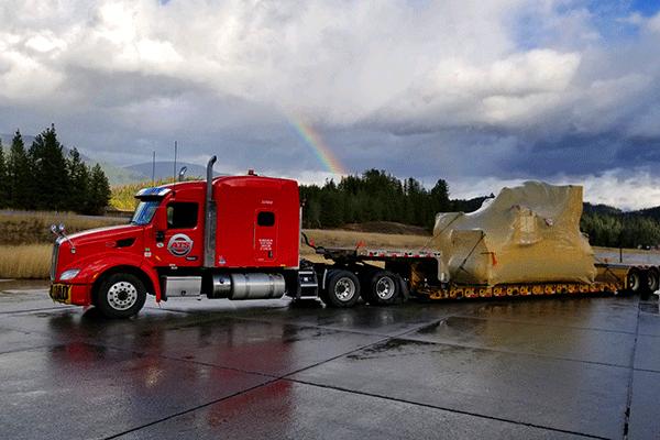 Lowboy trailer hauling freight