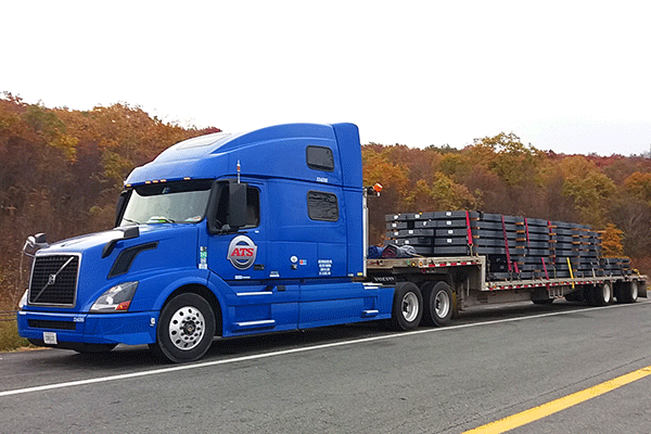 semi truck with step-deck trailer