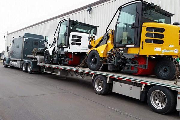 step deck trailer hauling construction freight