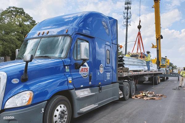 flatbed-trailer-being-crane-loaded