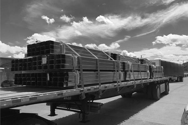 flatbed-hauling-steel-tubbing