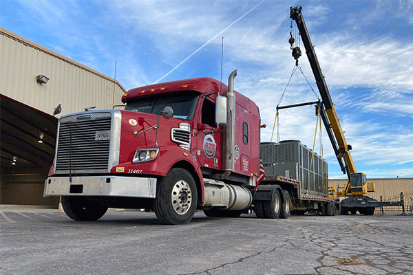 crane-loaded-step-deck-freight