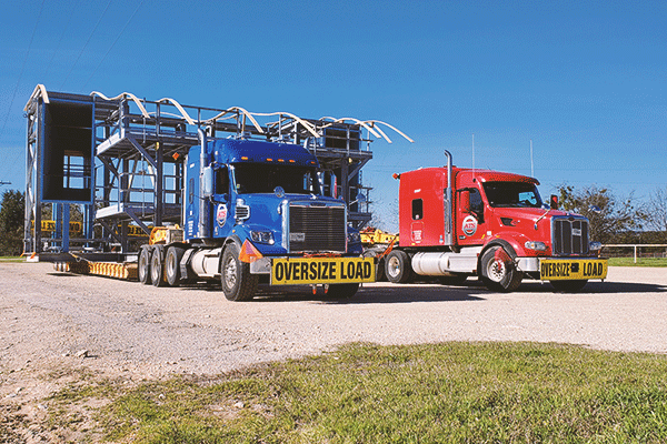 Two oversized semi loads