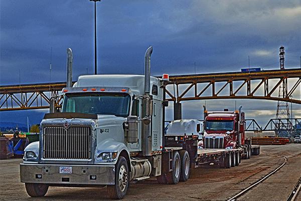 three semi trucks crossing the international border