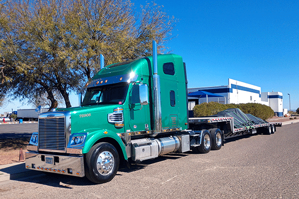 Step deck trailer hauling freight