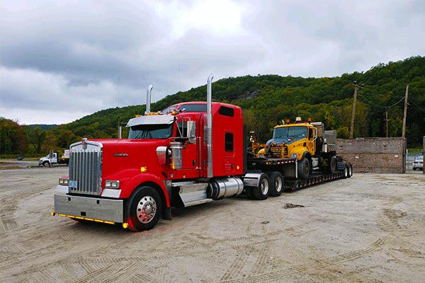 lowboy-trailer-hauling-machinery