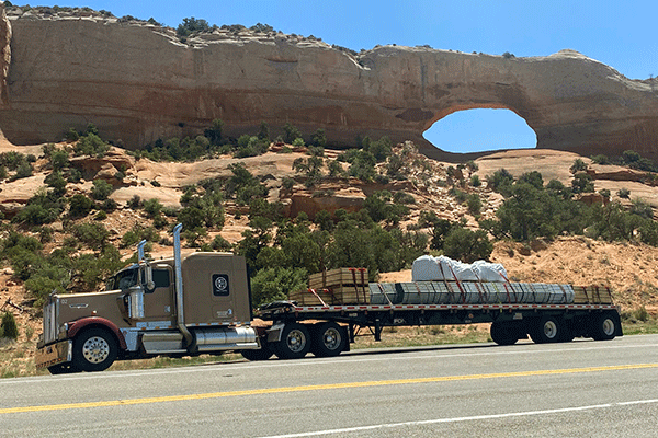 flatbed freight shipment driving down the highway