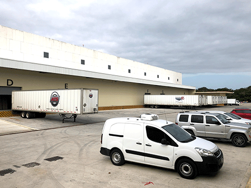 Trailers at loading dock of warehouse facility