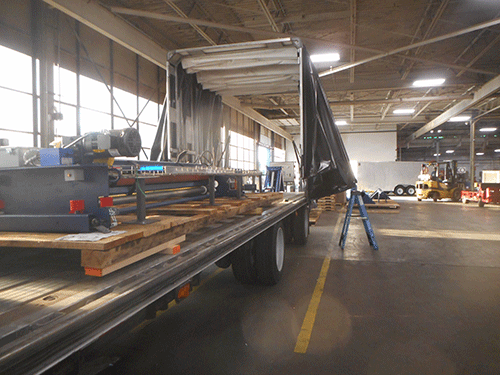 Flatbed Conestoga being loaded