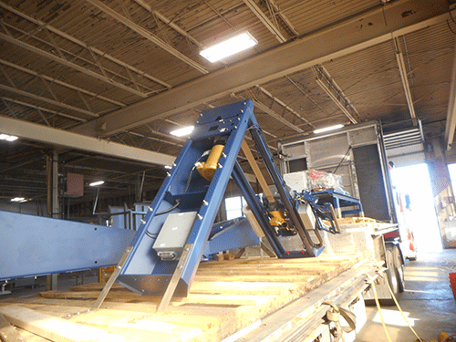 Step Deck Conestoga Trailer being loaded