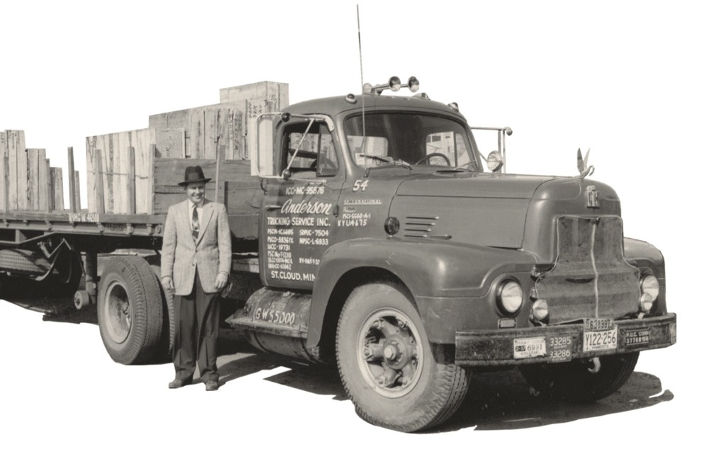 Harold Anderson standing in front of an old truck