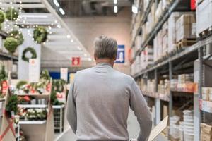 Man Shopping During Holiday Season in Retail Store