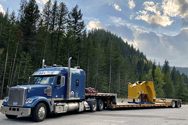 Double drop trailer loaded with freight
