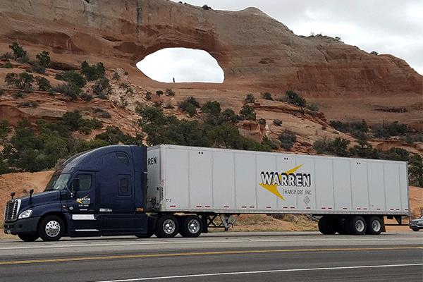 Van semi trailer on interstate