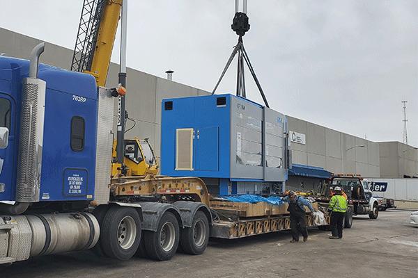 Heavy haul freight shipment getting loaded