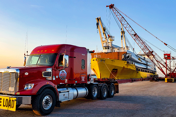 Truck parked at the port getting loaded