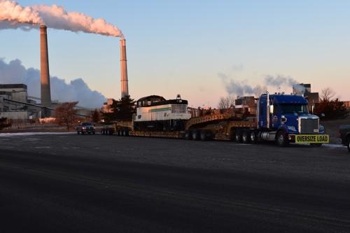 Historic locomotive sit on ATS 13-axle trailer