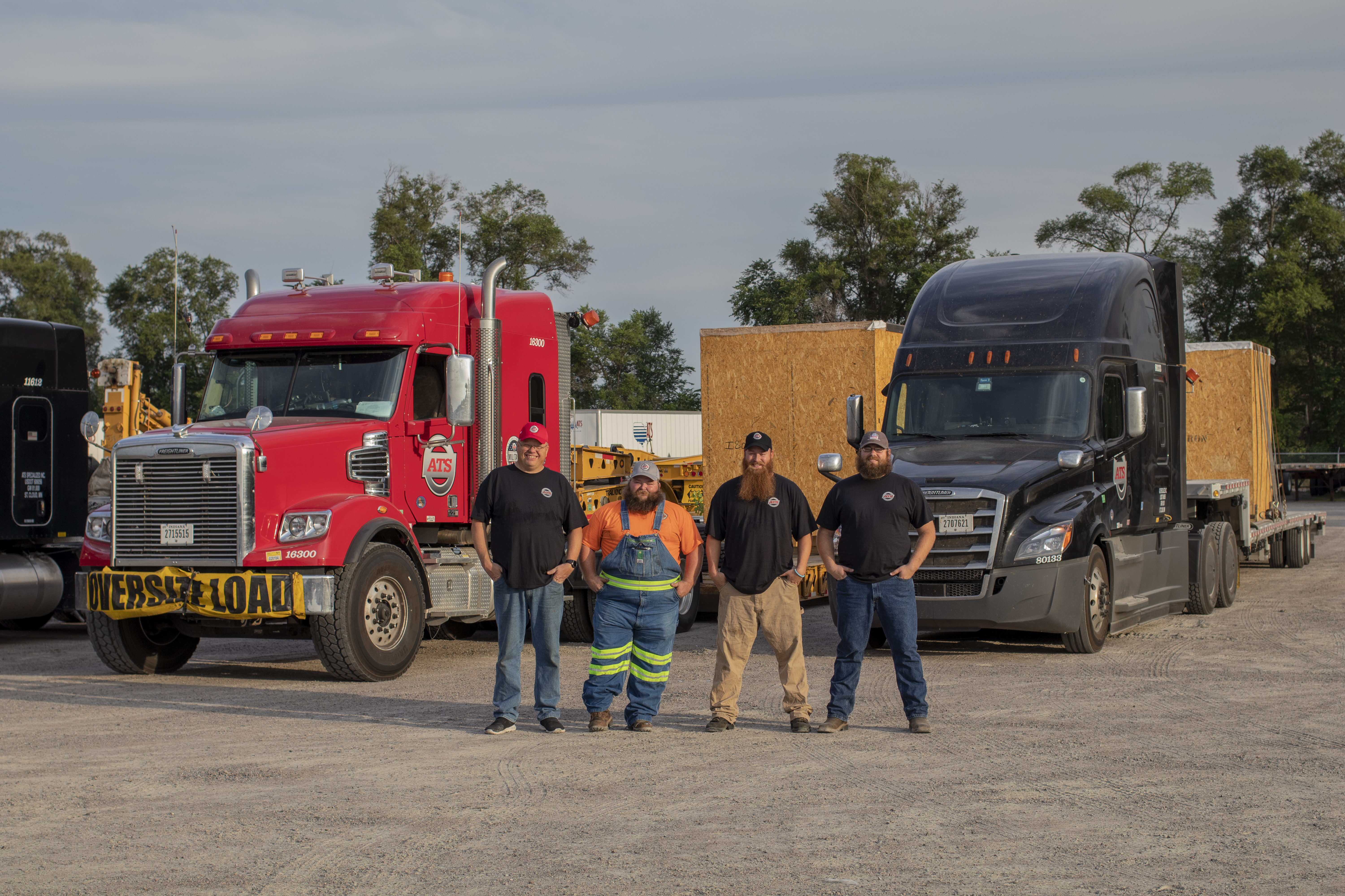 ATS Drivers pose in front of their trucks