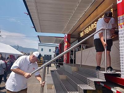ATS Driver helps assemble stairs for container bar
