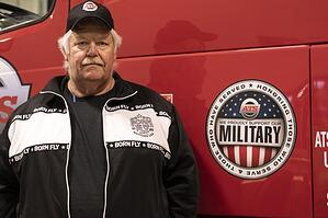 ATS Driver, Ron, standing in front of his truck