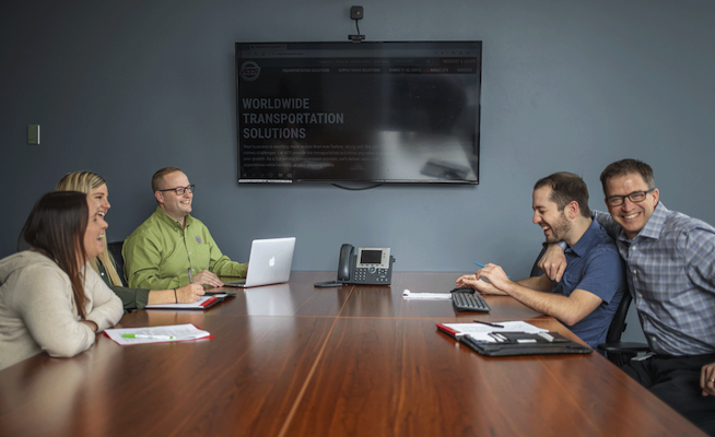 ATS team members in a conference room